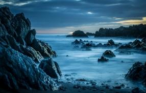 long exposure waves rocks